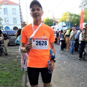 Robert Bagiński zawodnik trenujący u Emila bieg Ulicą Piotrkowską na 10km Łódź